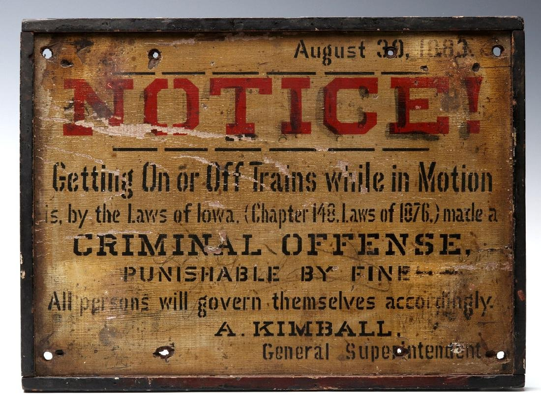 A PAINTED WOOD IOWA RAIL YARD SIGN DATED 1883