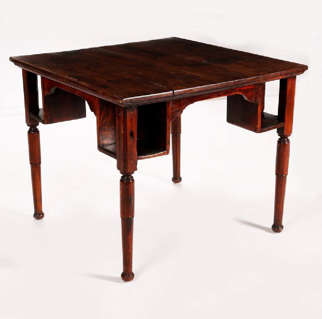 AN ANTIQUE PUB TABLE