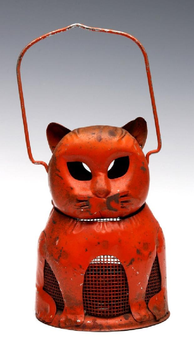 A VERY UNUSUAL ORANGE TIN CAT HALLOWEEN LANTERN