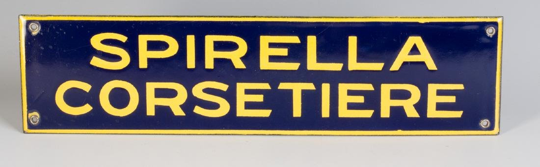 A PORCELAIN ENAMEL SIGN FOR SPIRELLA CORSETIERE