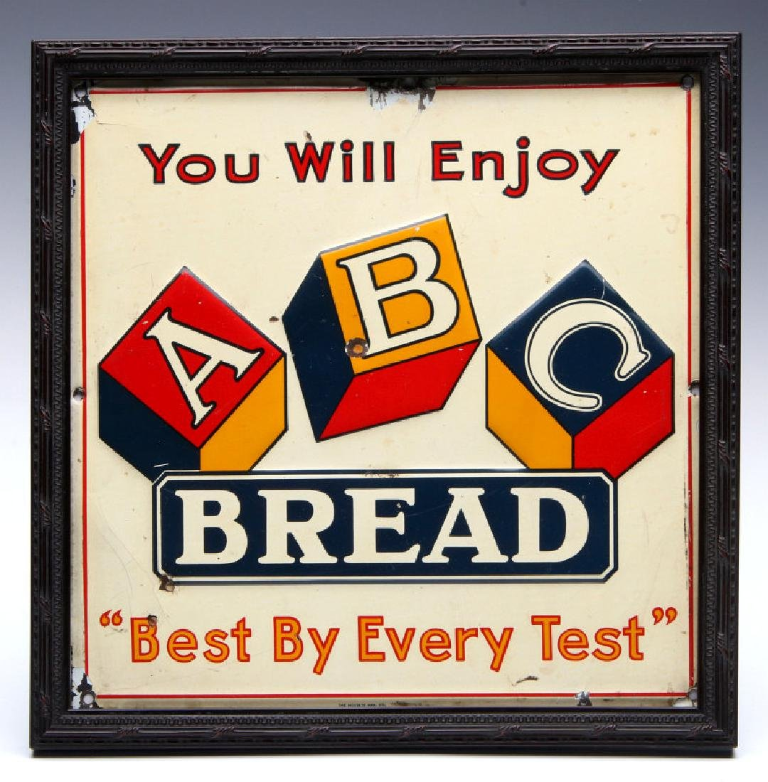 AN EMBOSSED TIN SIGN FOR ABC BREAD CIRCA 1930s