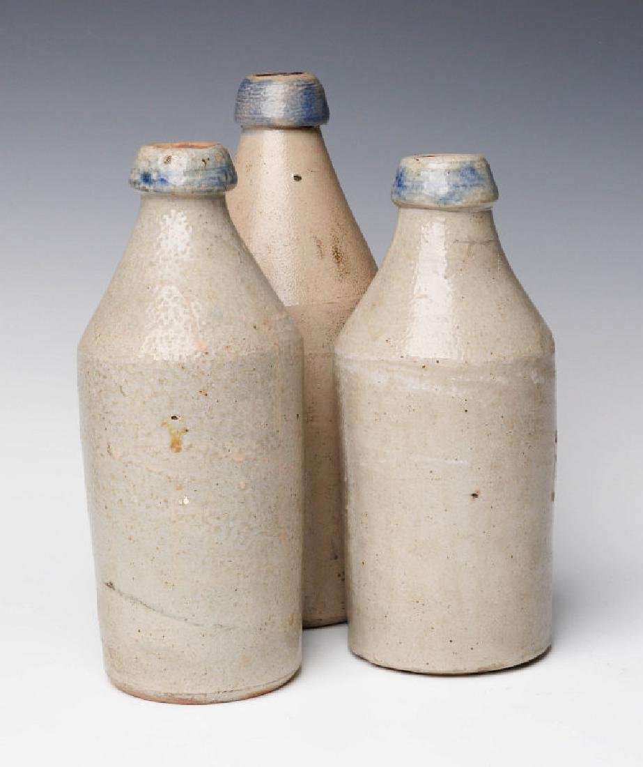 THREE 19TH C. BLUE DECORATED STONEWARE BOTTLES