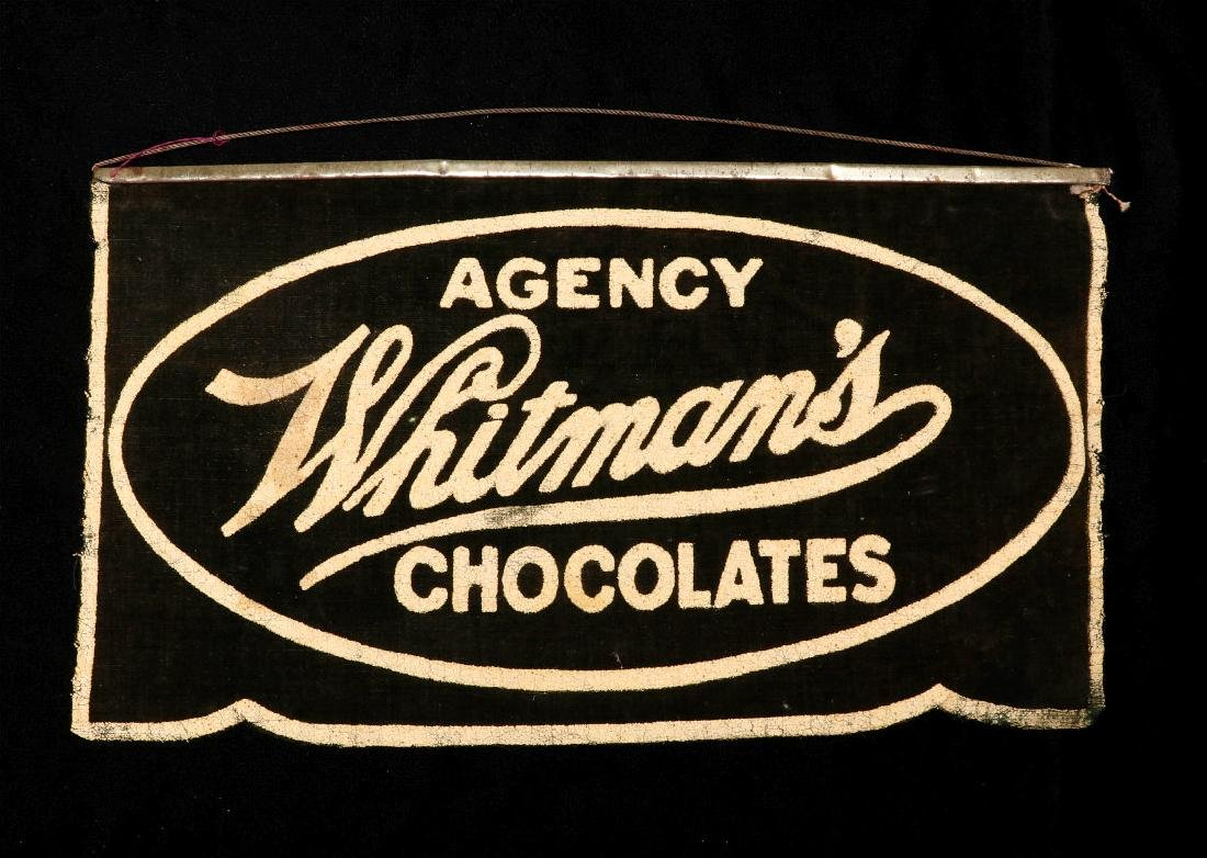 A WHITMAN'S CHOCOLATES ADVERTISING BANNER C. 1920s