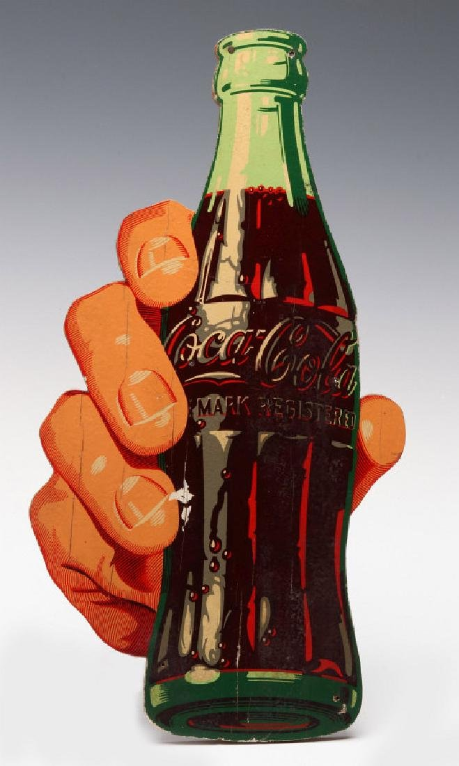 A PAINTED WOOD COCA-COLA FIGURAL HAND AND BOTTLE