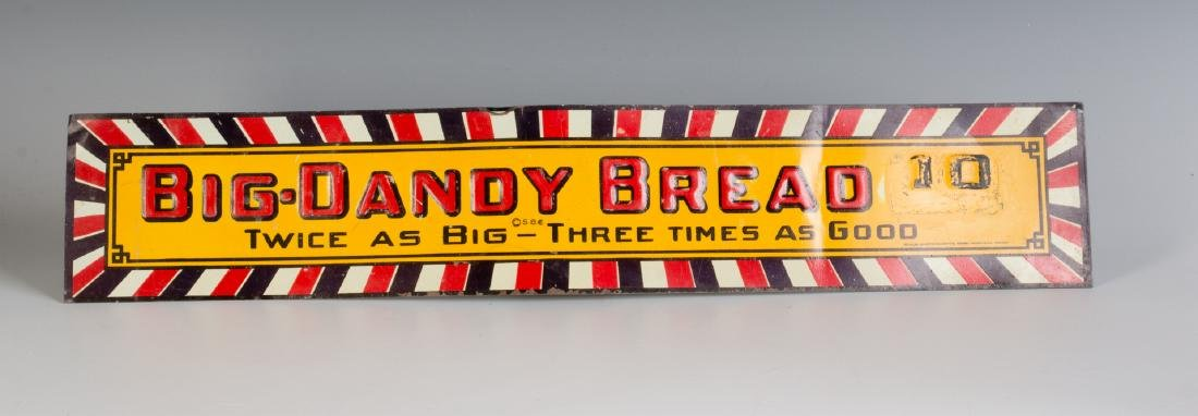A VINTAGE EMBOSSED TIN SIGN FOR BIG DADDY BREAD