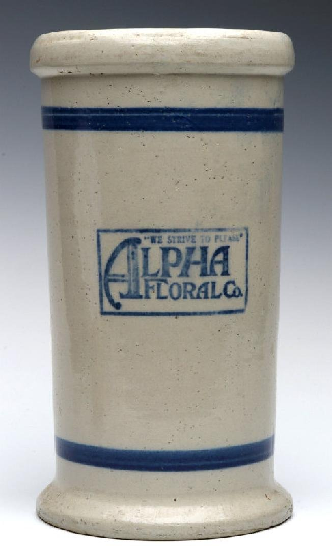 AN ALPHA FLORAL STONEWARE VASE BY RED WING POTTERY
