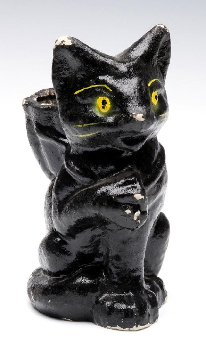 A VINTAGE HALLOWEEN BLACK CAT CANDY CONTAINER