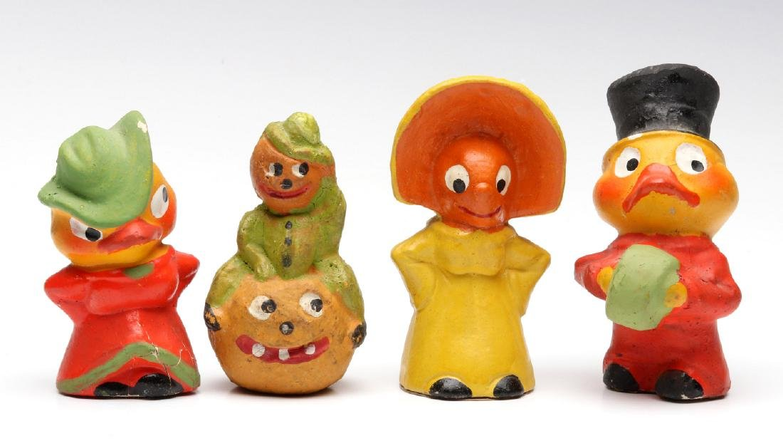 FOUR GERMAN PLASTER NOVELTY FIGURES