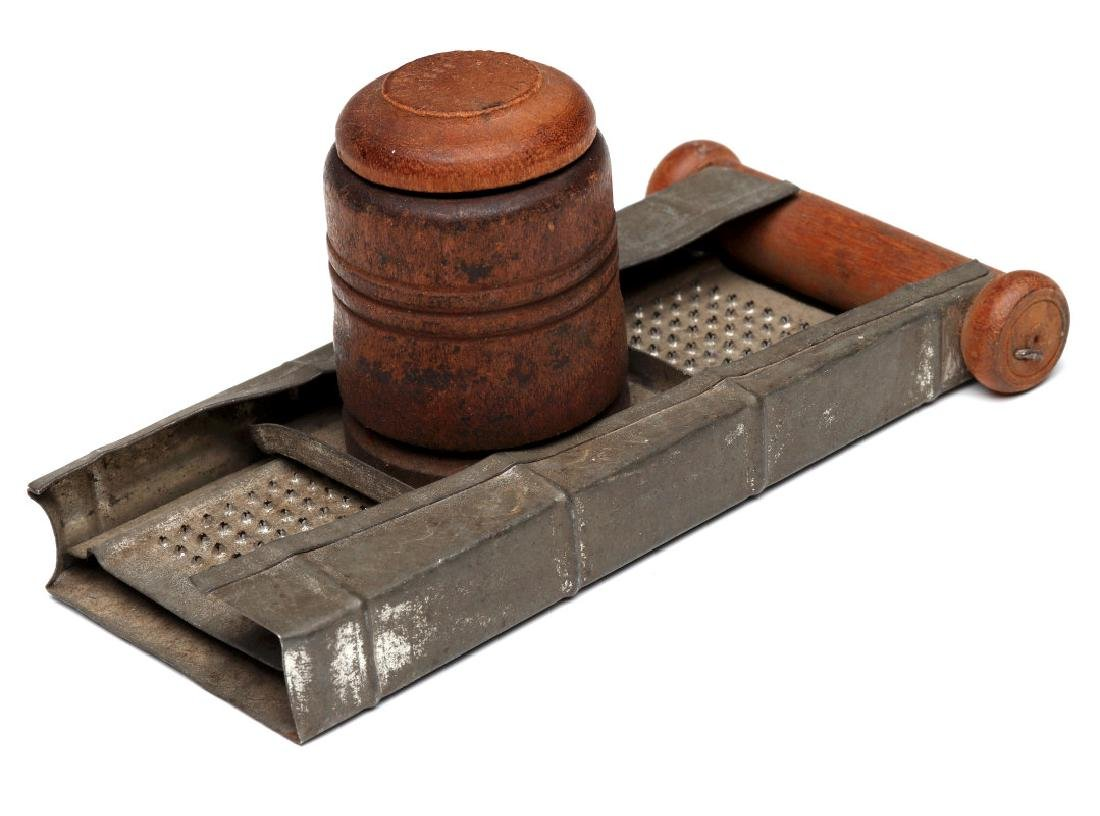 AN ANTIQUE NUTMEG GRATER
