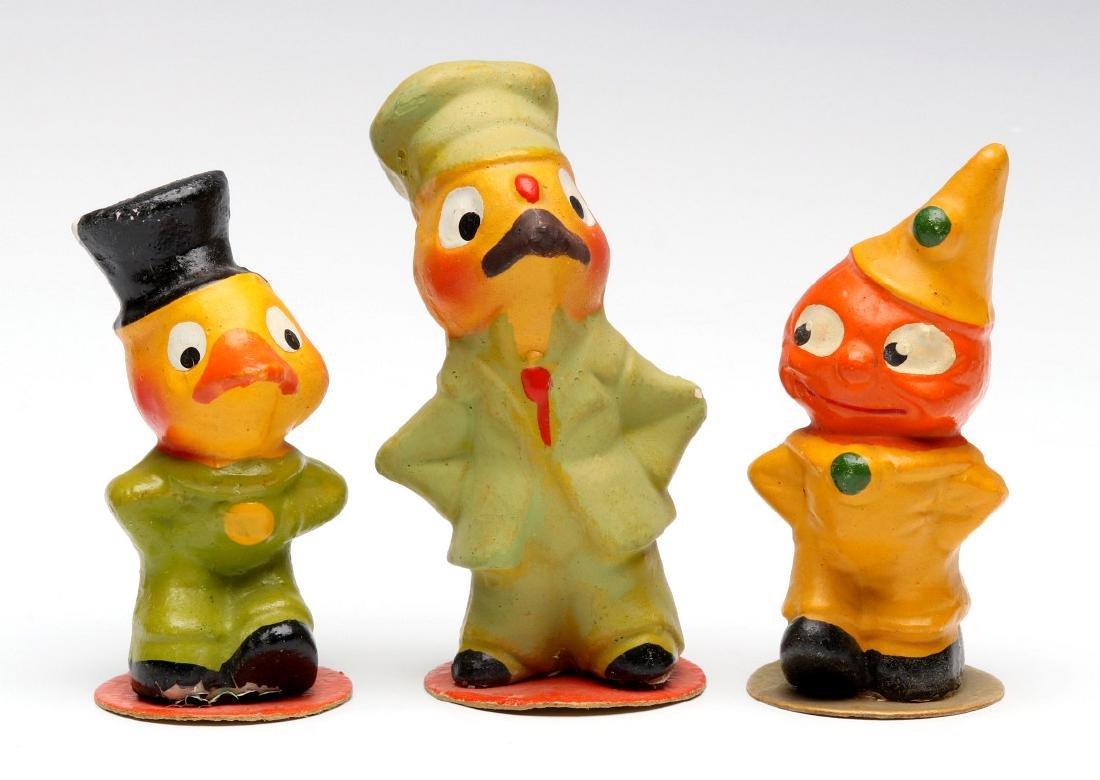 THREE GERMAN PLASTER NOVELTY FIGURES