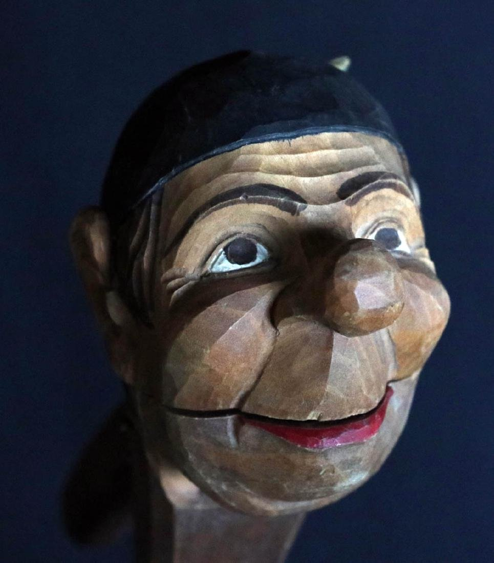 A CARVED AND PAINTED WOOD CARICATURE NUT CRACKER