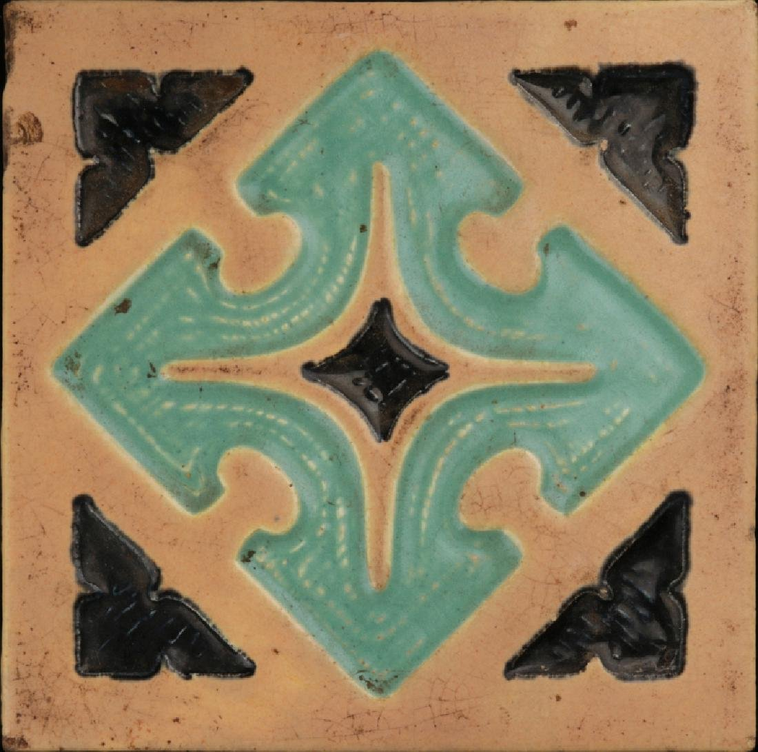 A CARVED AND GLAZED TERRA COTTA ARCHITECTURAL TILE