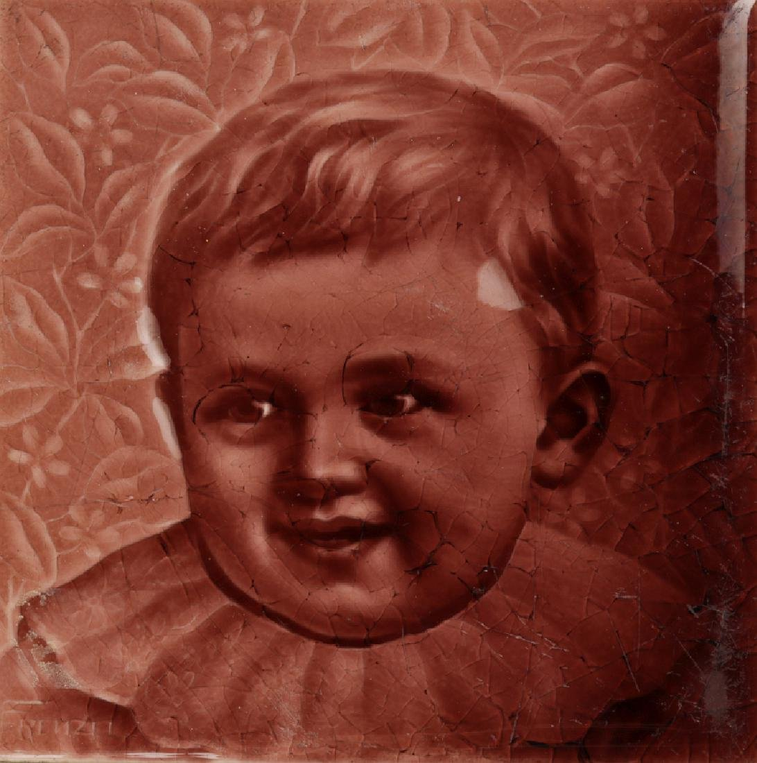 A 19TH C. GLAZED TILE WITH A PORTRAIT OF A CHILD