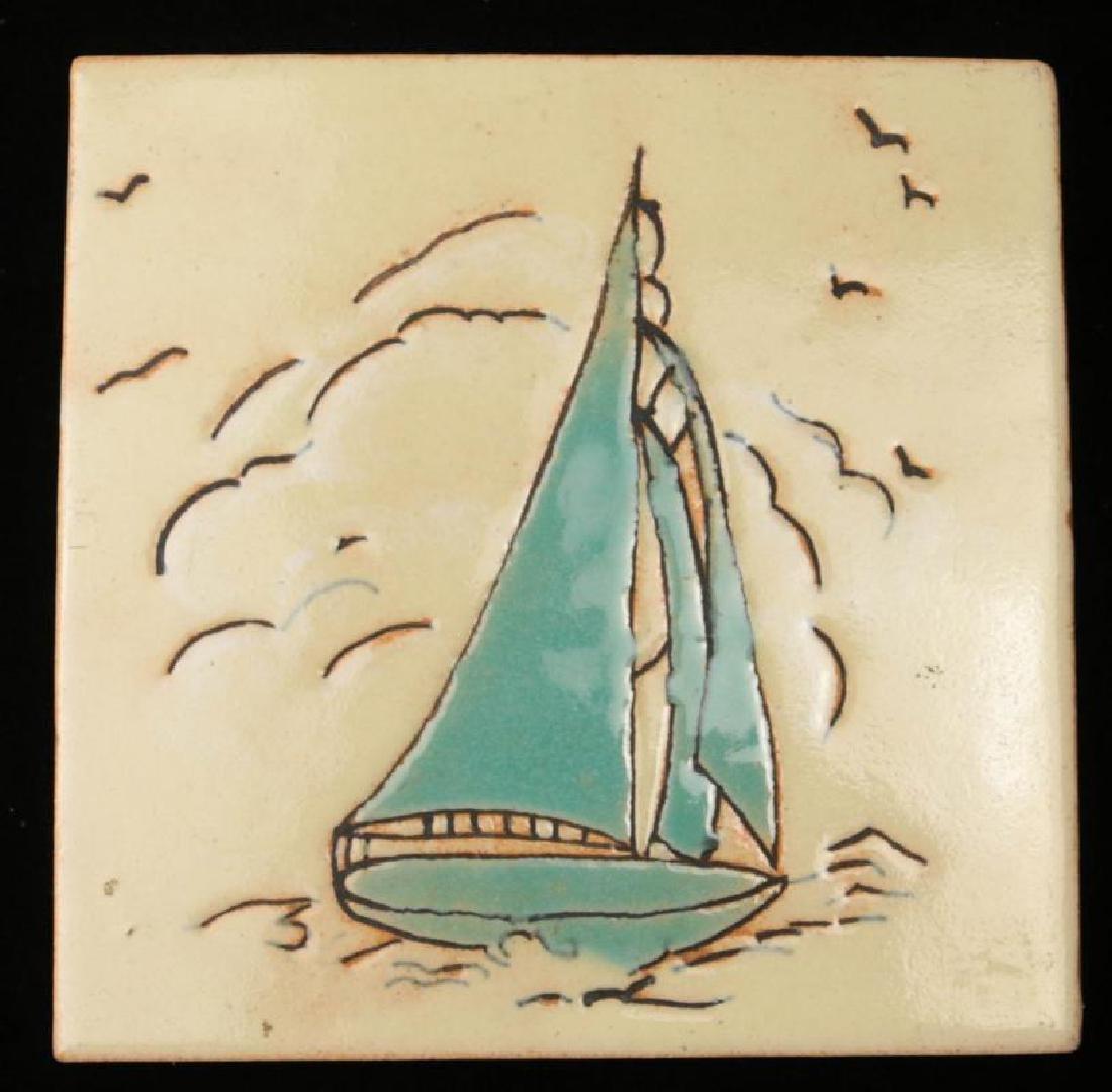 AN EARLY 20TH C. GLAZED TERRA COTTA ART TILE