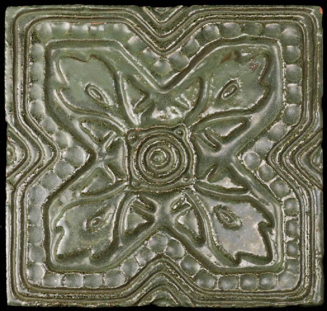 A CIRCA 1900 MATTE GREEN CARVED TERRA COTTA TILE