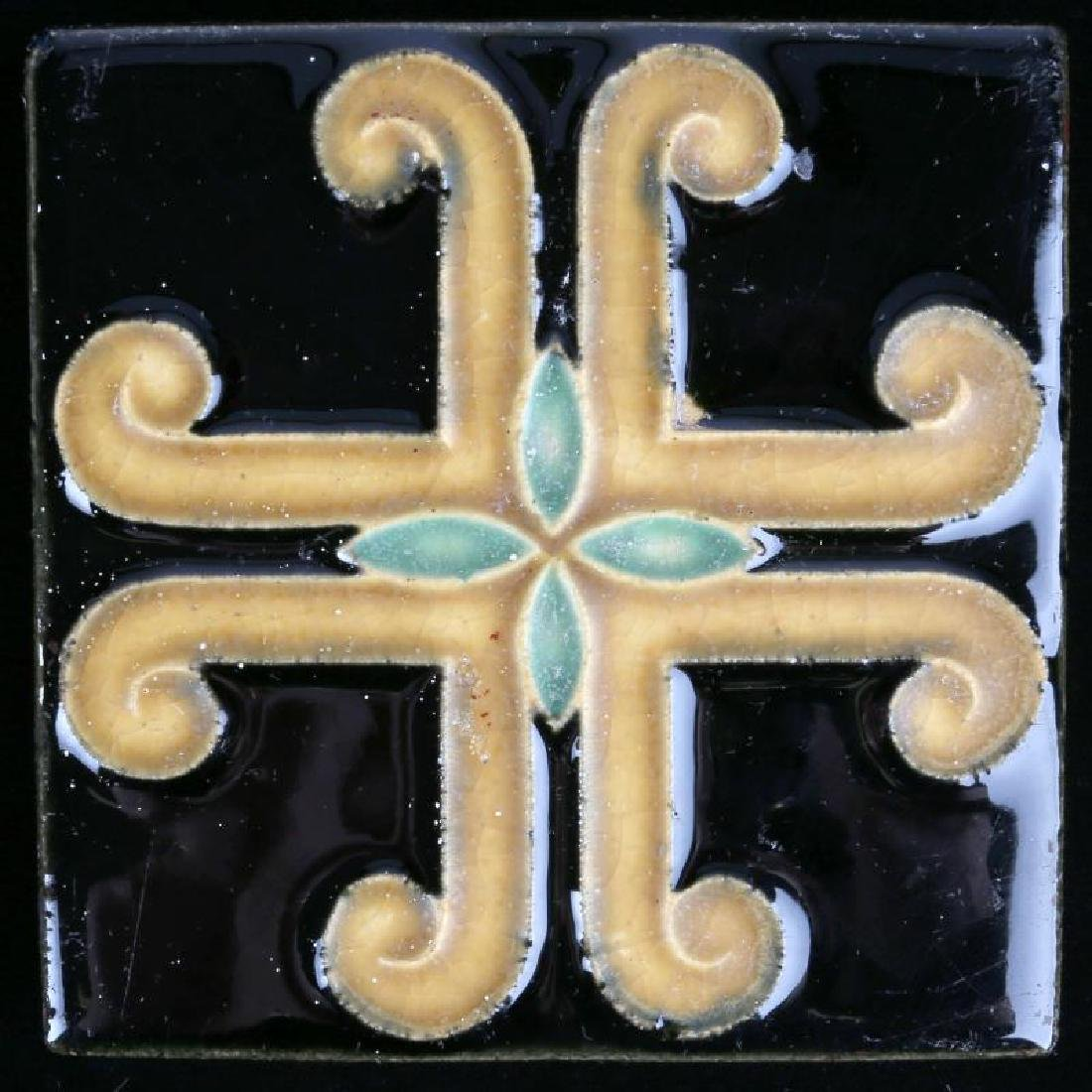 AN ARCHITECTURAL TILE WITH STYLIZED MALTESE CROSS