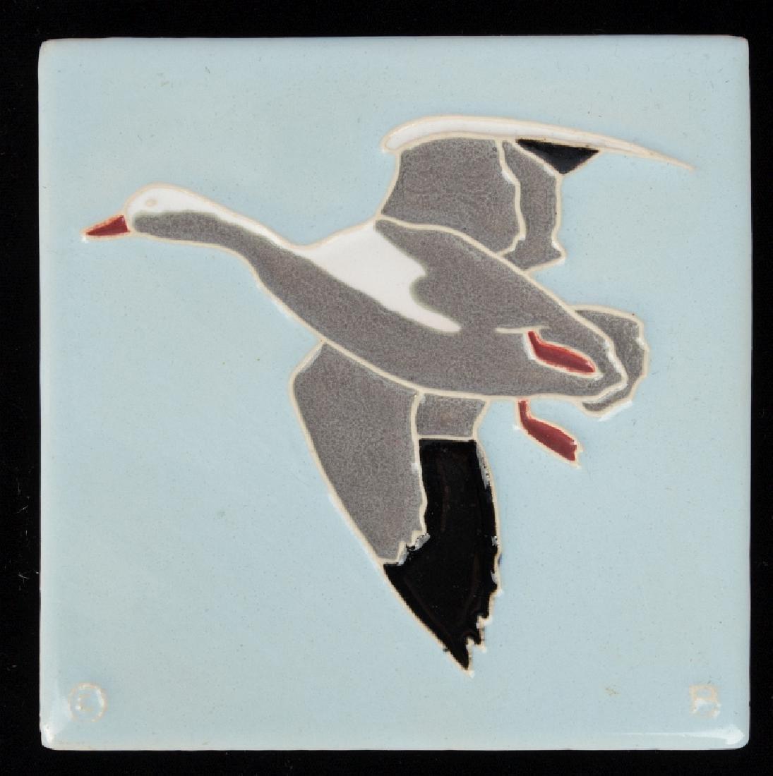 A VINTAGE MOSAIC ART TILE, GOOSE IN FLIGHT