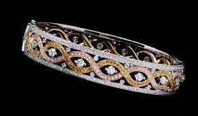 A TRI-COLOR 18K GOLD AND DIAMOND BRACELET