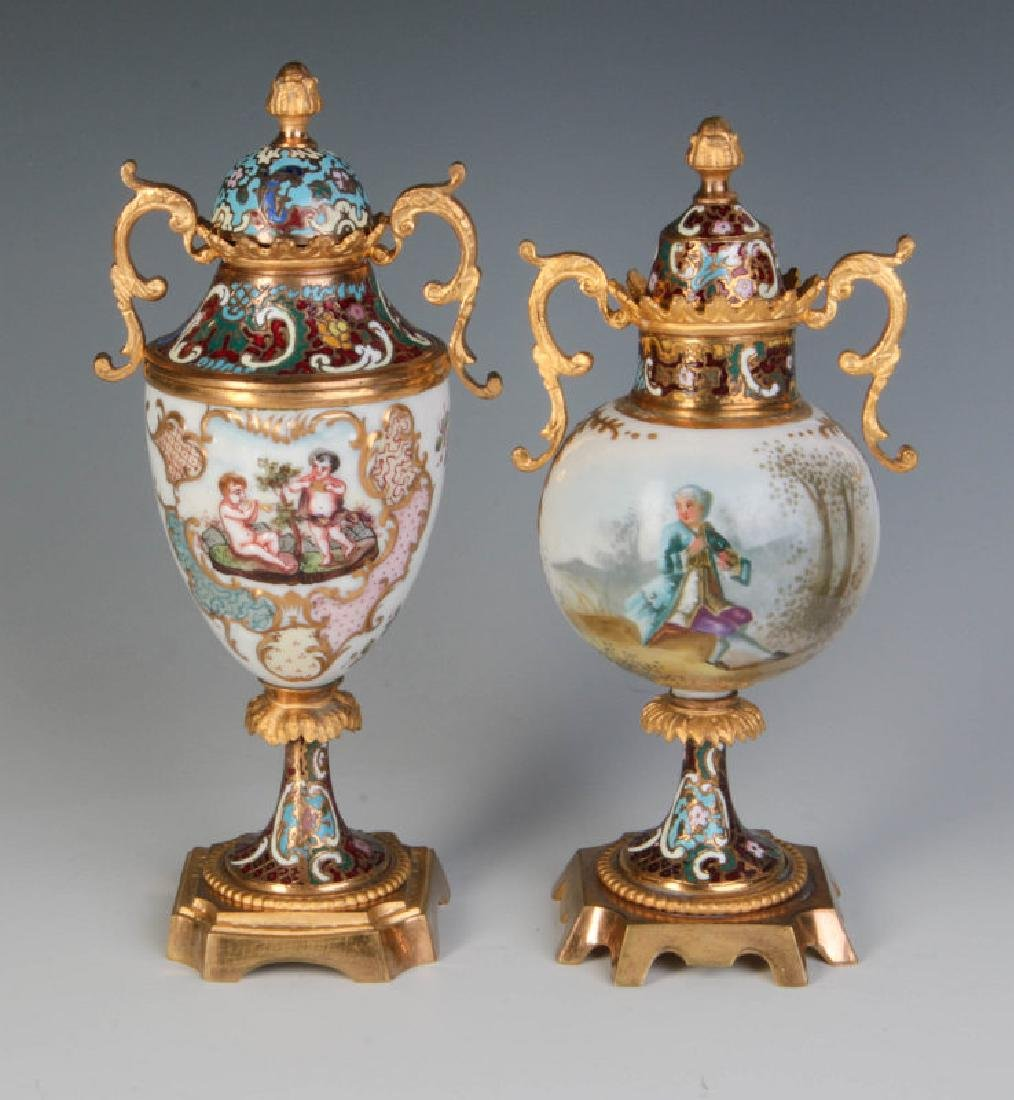 TWO CONTINENTAL CHAMPLEVE' BRONZE MOUNTED URNS