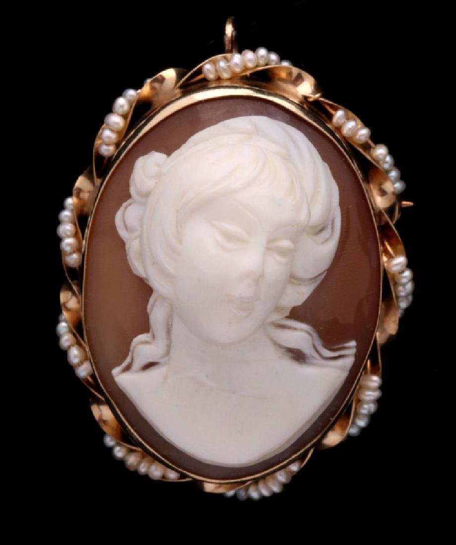 AN ANTIQUE CARVED SHELL CAMEO IN HIGH RELIEF, 14K