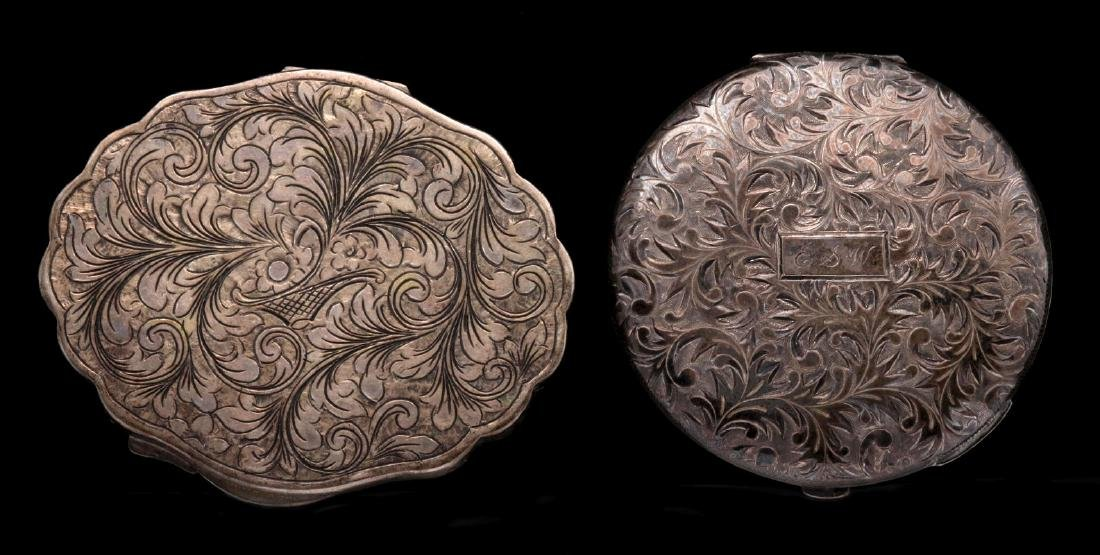 A HAND-CHASED STERLING COMPACT, PLUS ANOTHER
