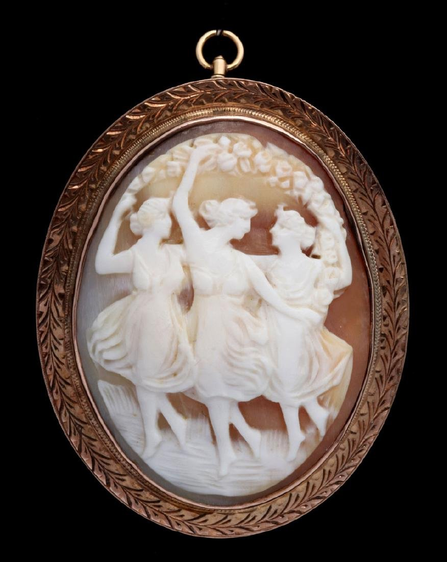 AN ANTIQUE 10K GOLD SHELL CAMEO - THE THREE GRACES