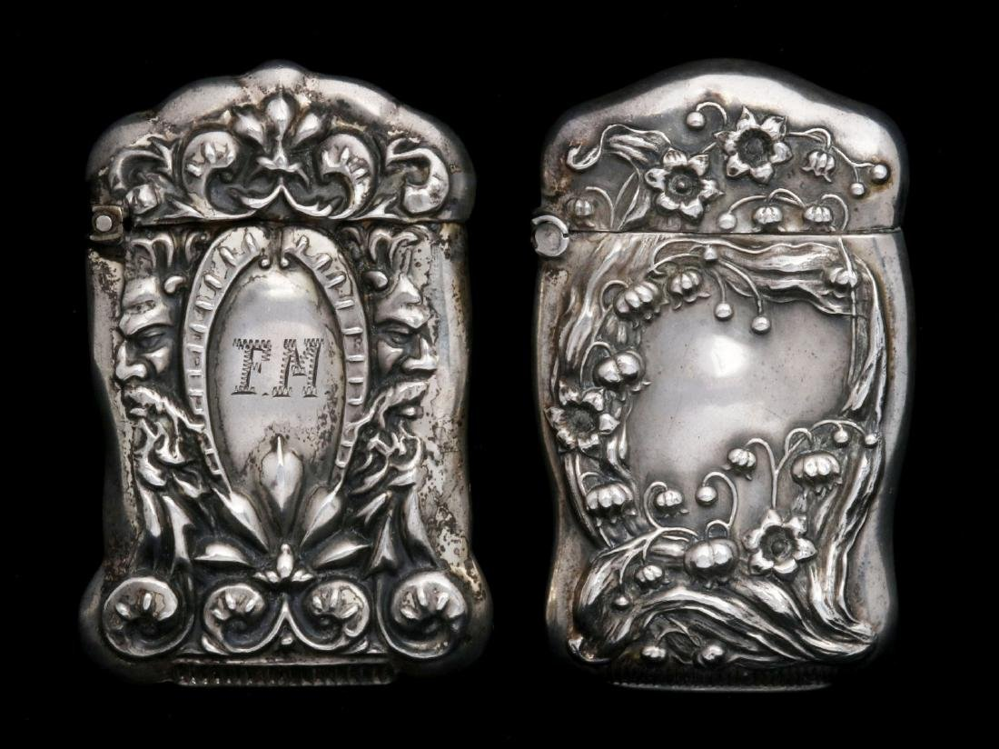 TWO ANTIQUE STERLING SILVER MATCH SAFES
