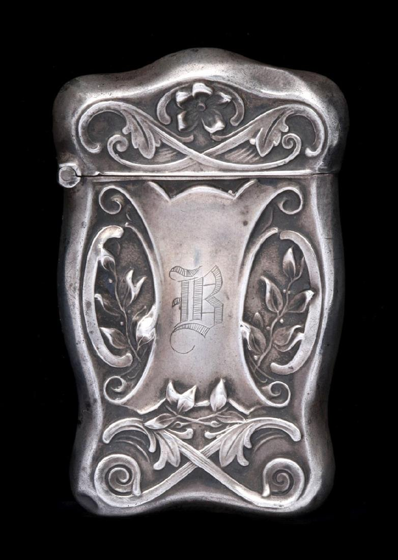 AN ANTIQUE STERLING SILVER MATCH SAFE
