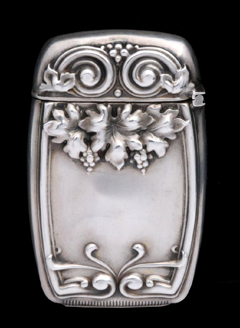 AN ANTIQUE STERLING MATCH SAFE WITH VINEYARD THEME