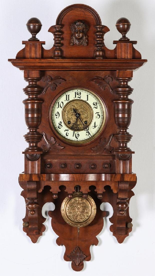 A GUSTAV BECKER OPEN WAG CLOCK WITH LADY'S HEAD