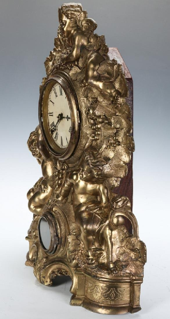 A NICHOLAS MULLER CAST IRON CLOCK WITH PUTTI - 10
