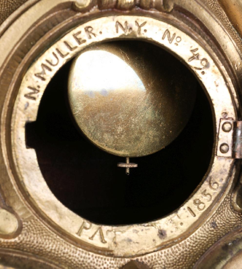 A NICHOLAS MULLER CAST IRON CLOCK WITH PUTTI - 12