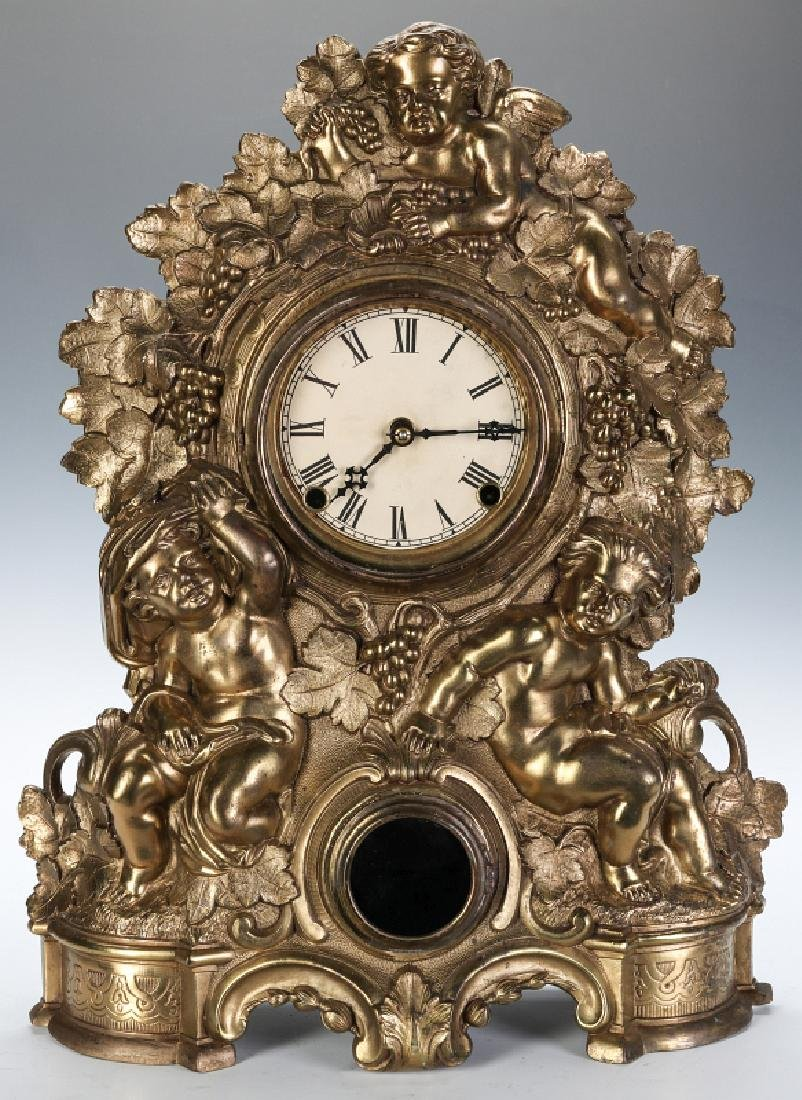 A NICHOLAS MULLER CAST IRON CLOCK WITH PUTTI