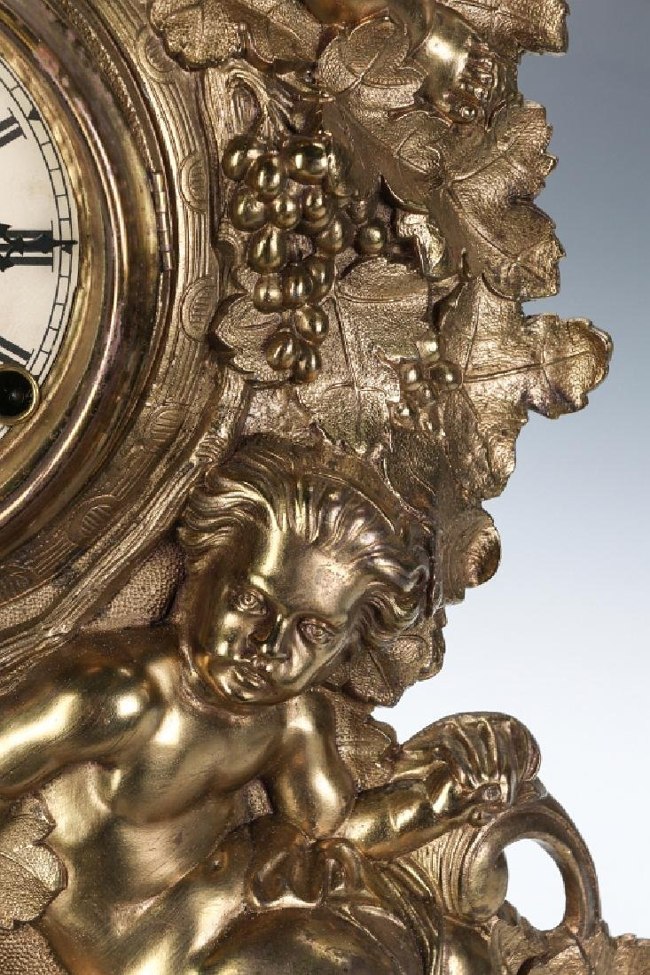 A NICHOLAS MULLER CAST IRON CLOCK WITH PUTTI - 3