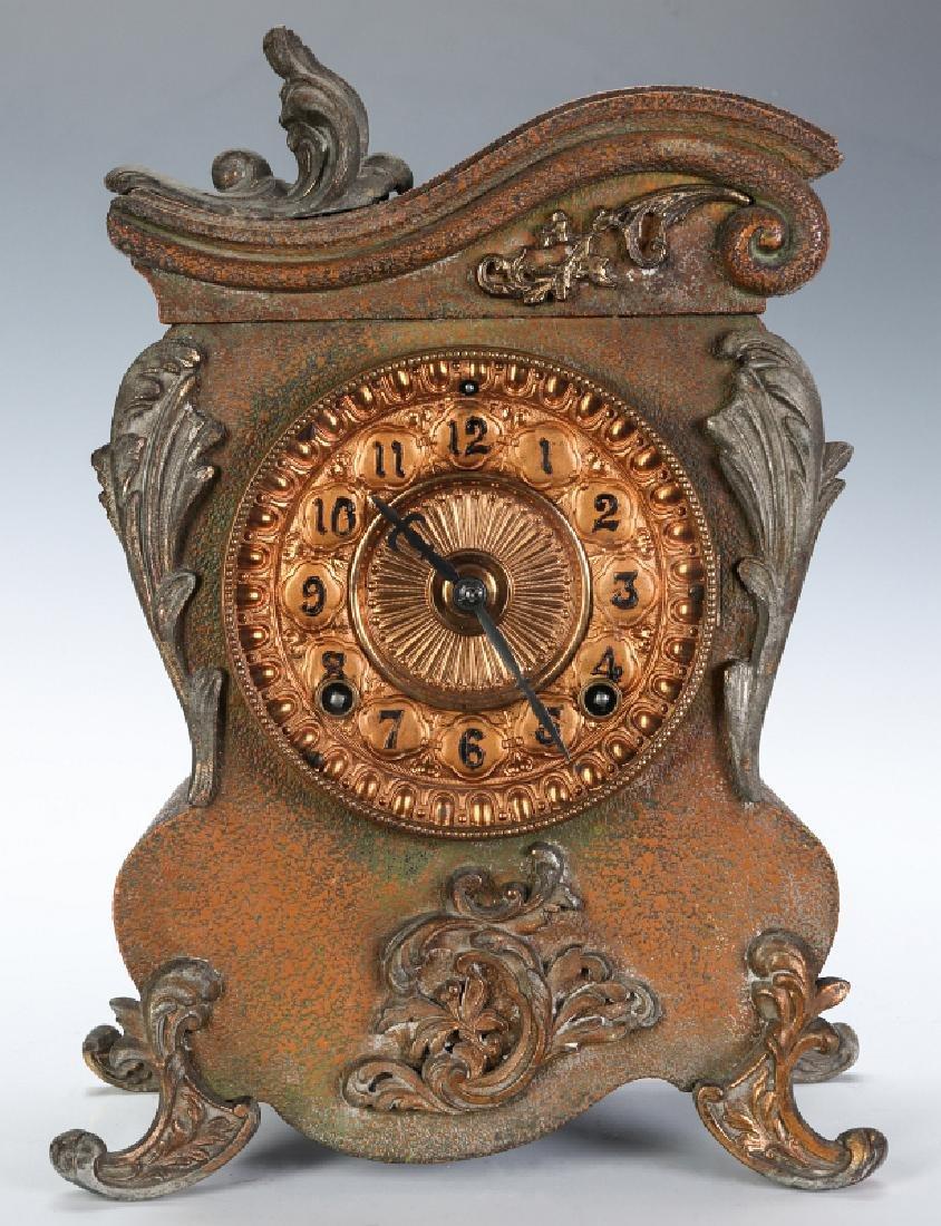 AN ANSONIA ORNATE ROCOCO STYLE IRON CLOCK