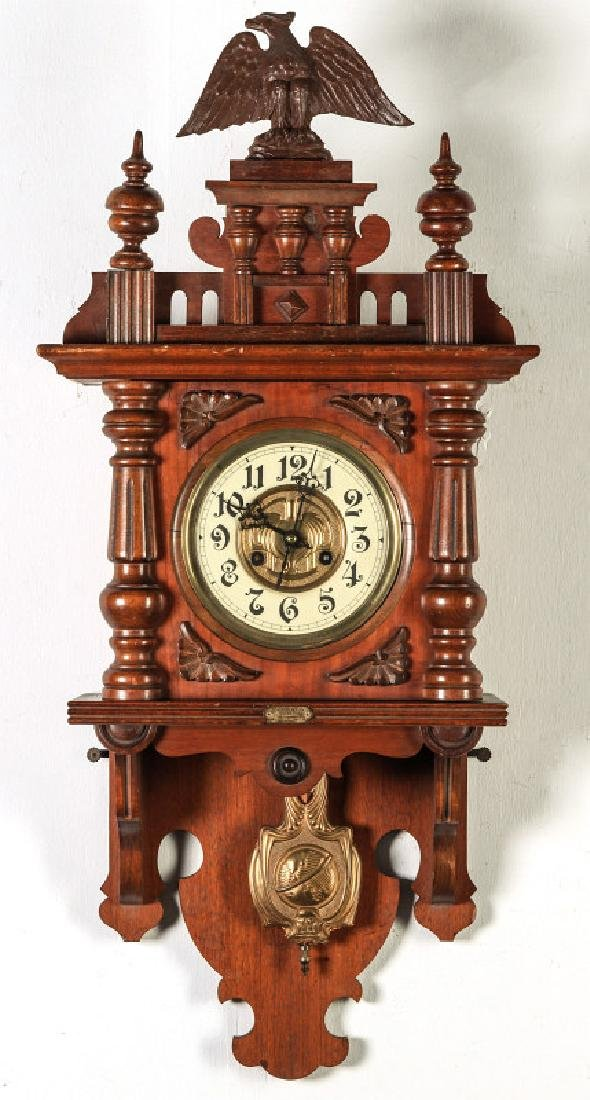 AN ORNATE JUNGHANS OPEN WAG WALL CLOCK WITH EAGLE