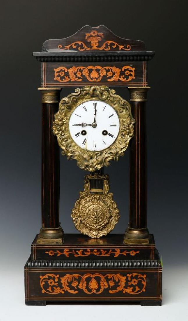 A 19TH CENTURY CONTINENTAL MARQUETRY PORTICO CLOCK