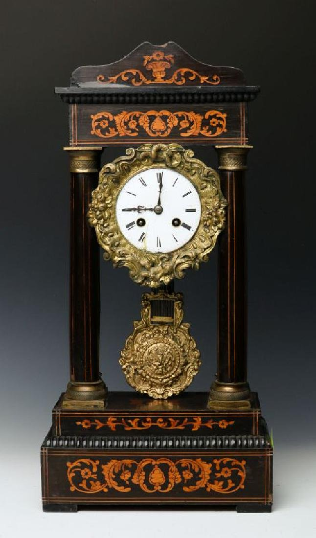 A 19TH CENTURY CONTINENTAL MARQUETRY PORTICO CLOCK