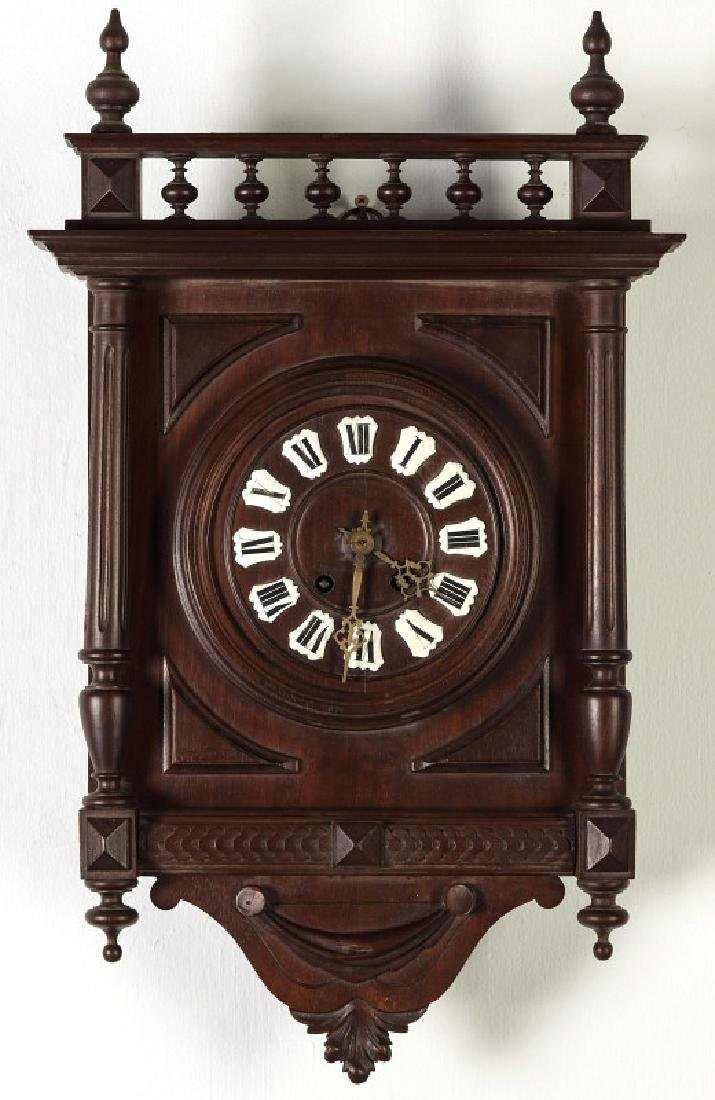 A 19TH CENTURY GERMAN BLACK FOREST WALL CLOCK