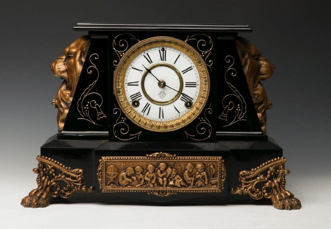 AN ANSONIA 'NUBIA' ENAMELED IRON MANTLE CLOCK