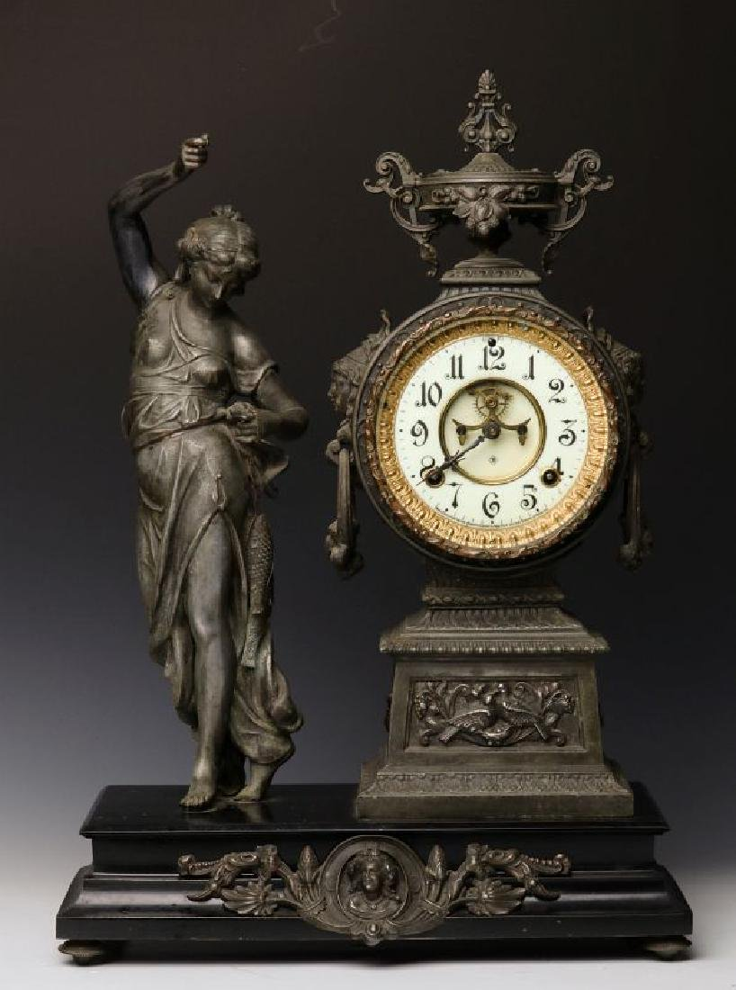 AN ANSONIA STATUE CLOCK WITH CLASSICAL MAIDEN