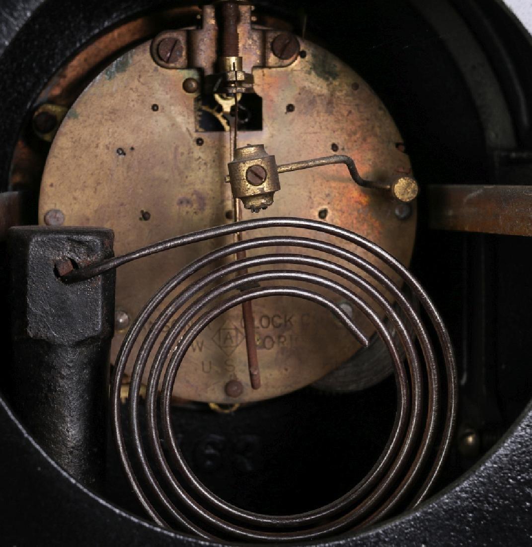 AN ANSONIA BLACK ENAMEL IRON MANTLE CLOCK - 12