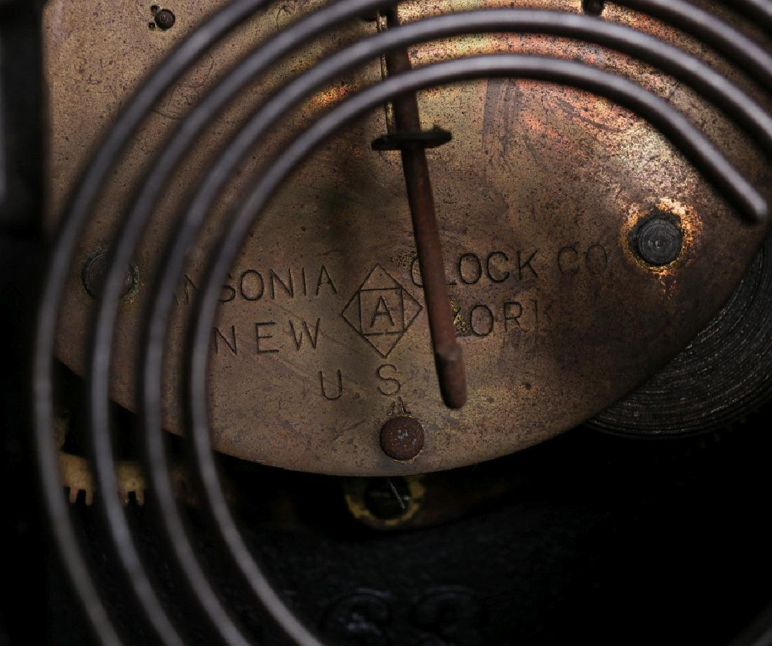 AN ANSONIA BLACK ENAMEL IRON MANTLE CLOCK - 13
