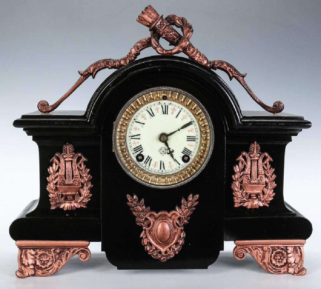 AN ANSONIA BLACK ENAMEL IRON MANTLE CLOCK