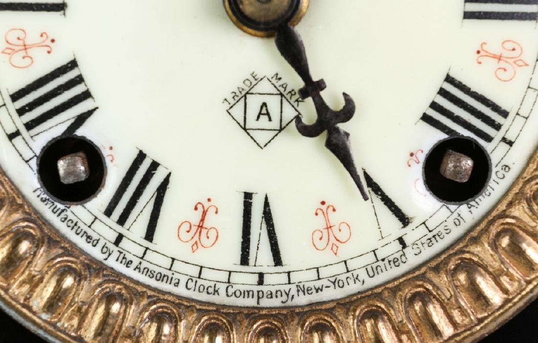 AN ANSONIA BLACK ENAMEL IRON MANTLE CLOCK - 7