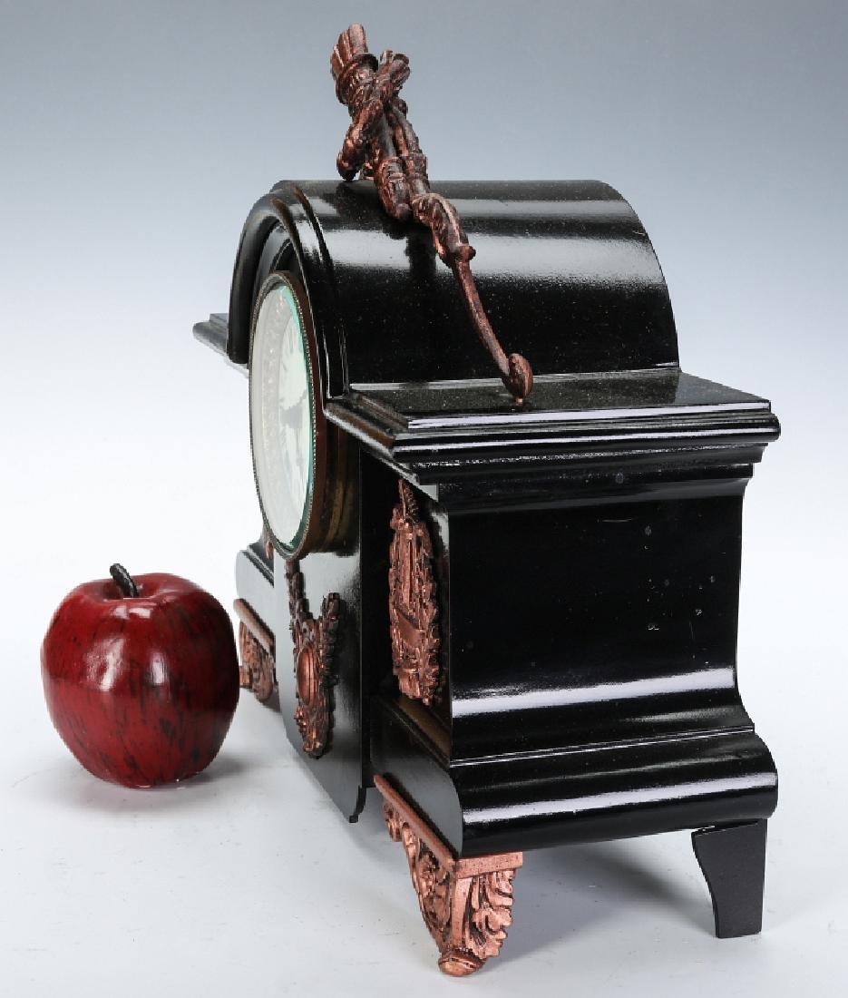 AN ANSONIA BLACK ENAMEL IRON MANTLE CLOCK - 9