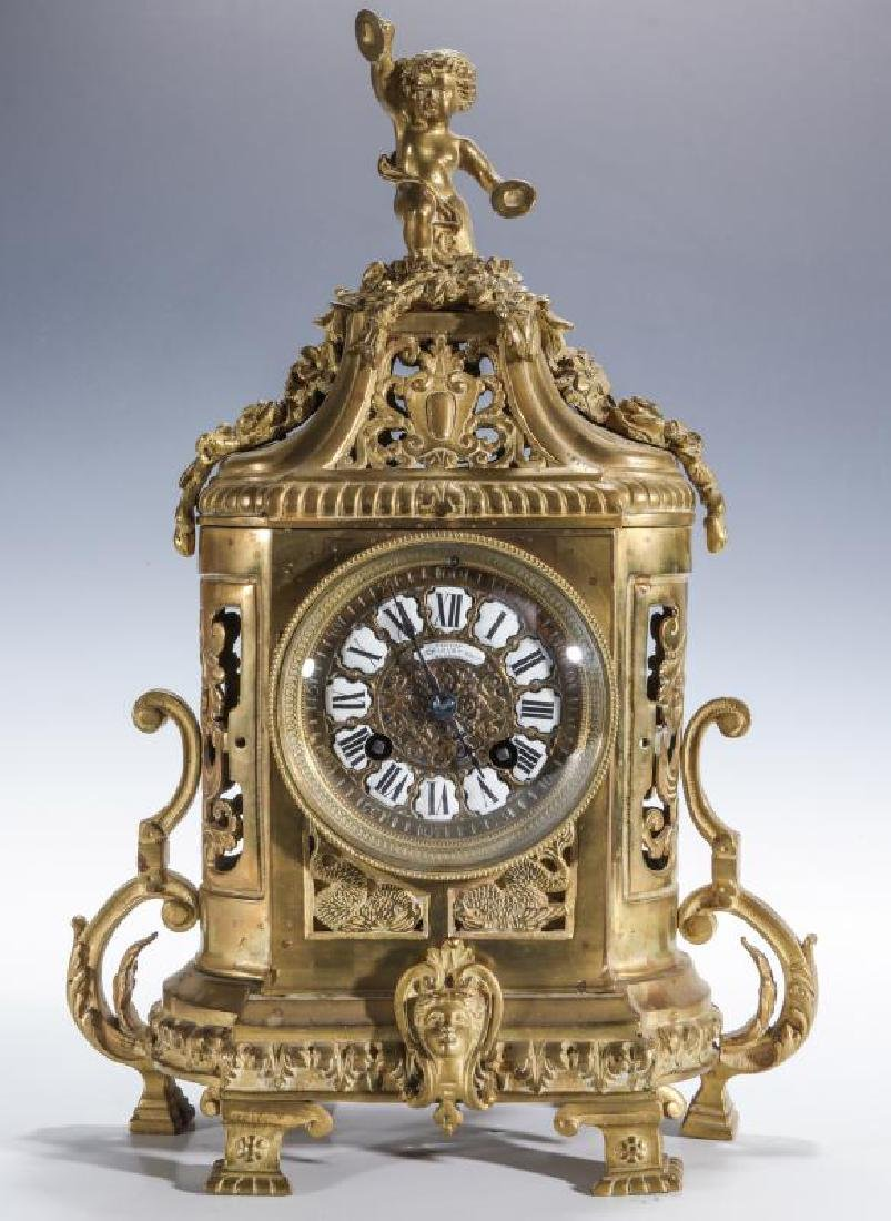 AN ORNATE BRASS CONTINENTAL TABLE CLOCK