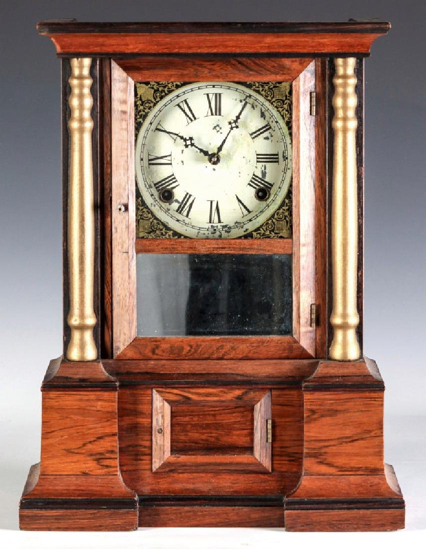 A MID 19TH CENT ROSEWOOD CLOCK ATTRIB TO ATKINS