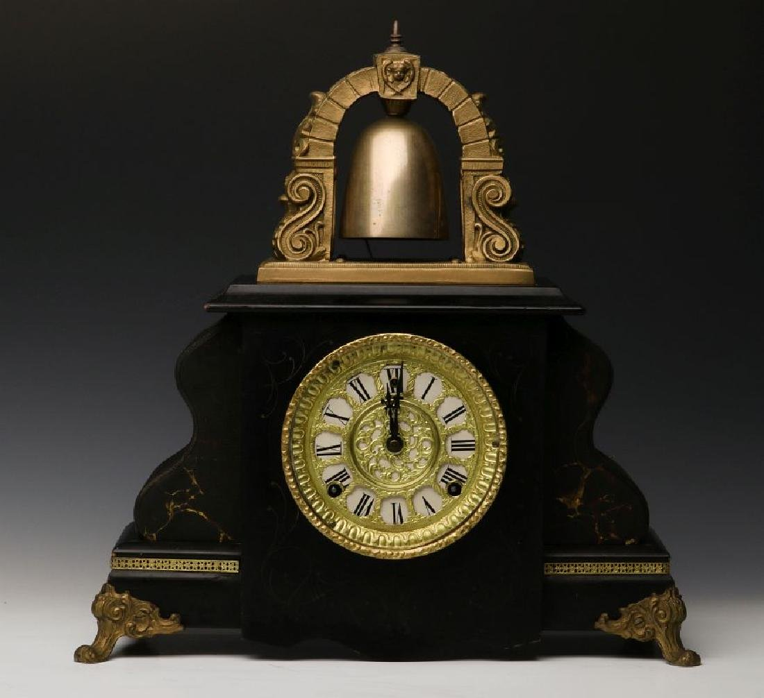A GILBERT 'CURFEW' BELL TOP SHELF CLOCK