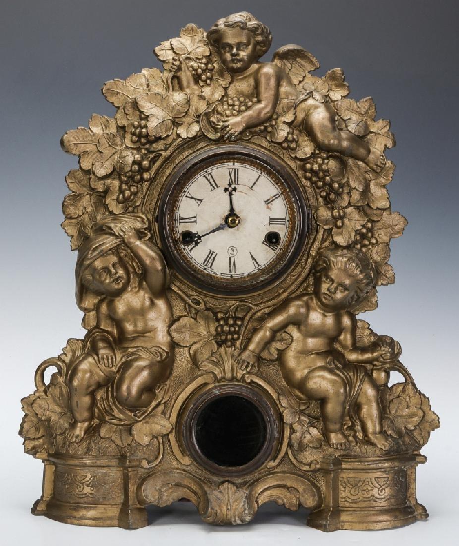 A NICHOLAS MULLER CAST IRON CLOCK WITH PUTTI